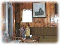 Our décor is knotty pine and plenty of relaxing furniture to relax on.